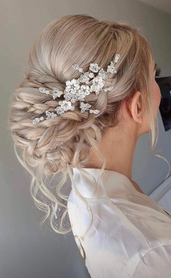 Photo of Magnolia Porcelain Flowers and Crystal Leaves Wedding Hair Clip uploaded by K on 31st March 2021