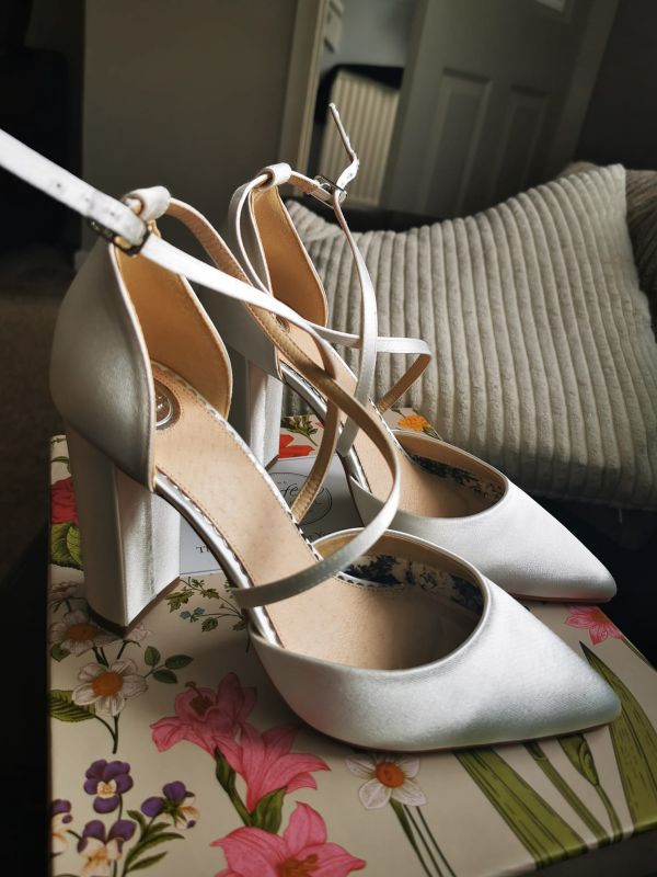 Photo of Perfect Bridal Kiera Dyeable Ivory Satin Cross Strap Block Heel Courts uploaded by K on 9th April 2021